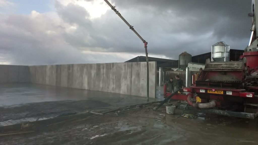 Pumping concrete into a Silage pit